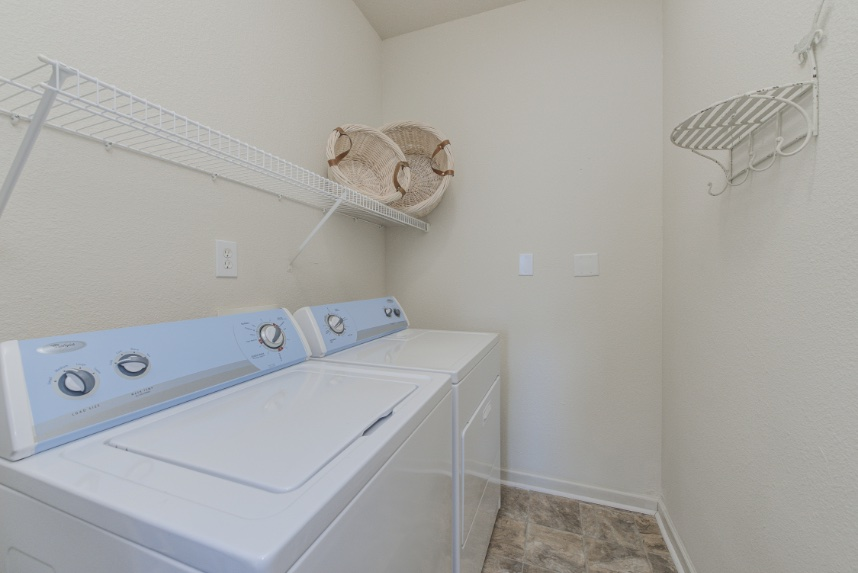 Laundry room with storage space in Westfield.